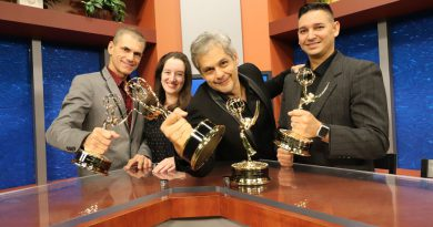 The people behind MDC-TV posing with their awards.