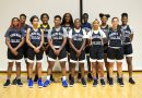 The Lady Sharks basketball team posing for the camera.