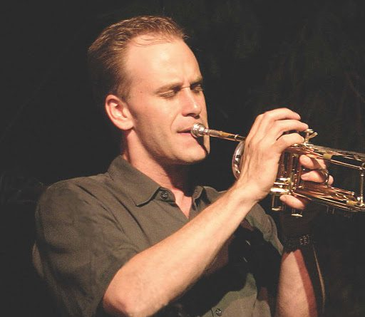 Scott Wendholt paying his trumpet on stage.