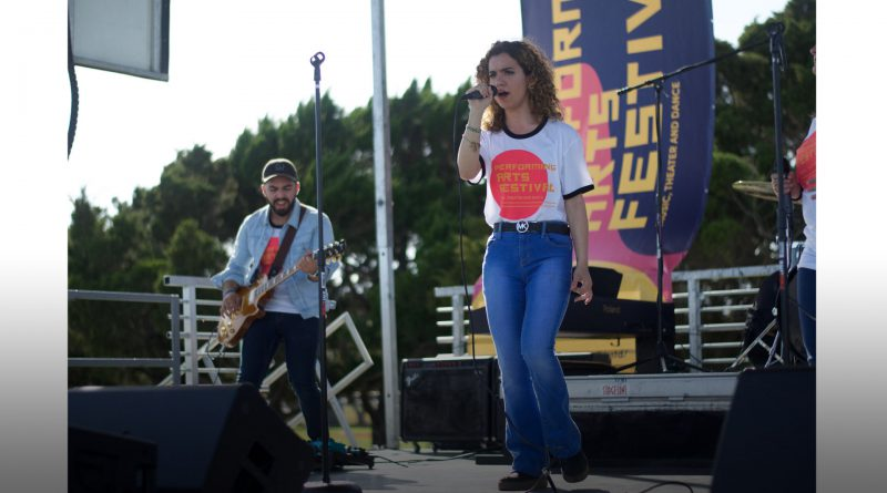 Paiige performing on stage.