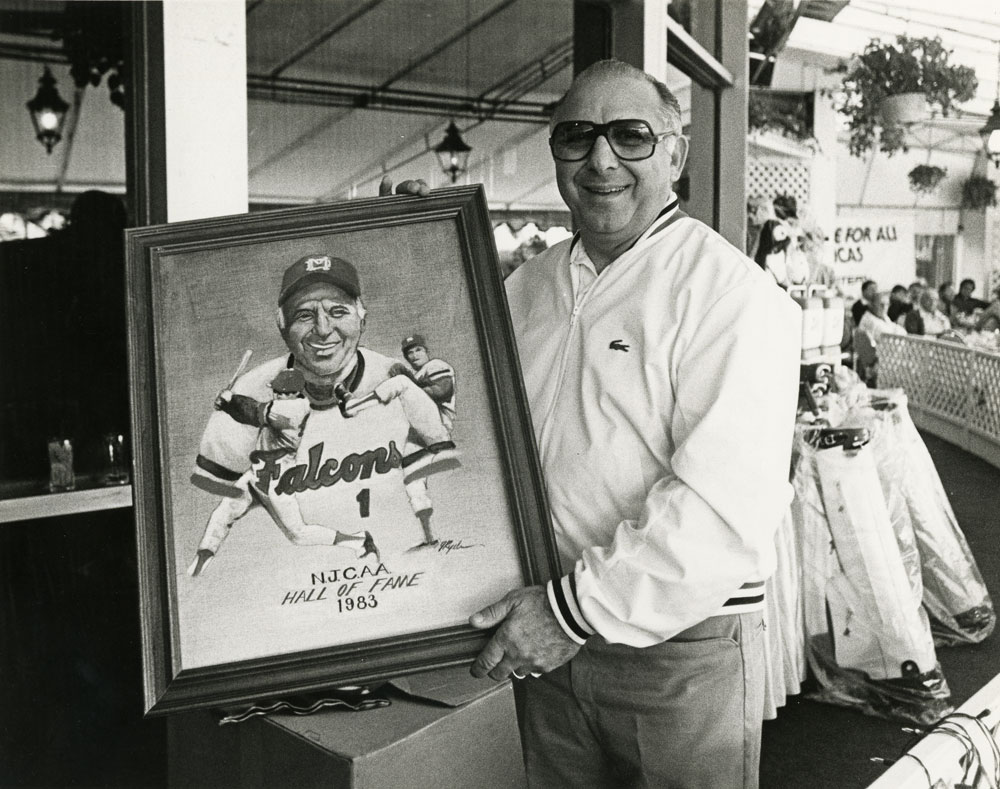 Demie Mainieri holding an artwork dedicated to him.