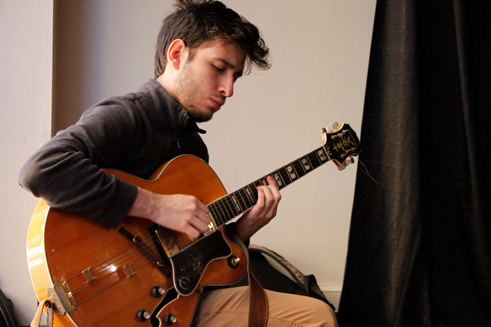 Student playing guitar.
