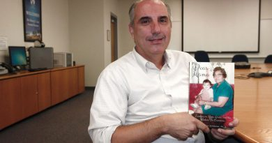 Shawn Schwaner posing with his book.