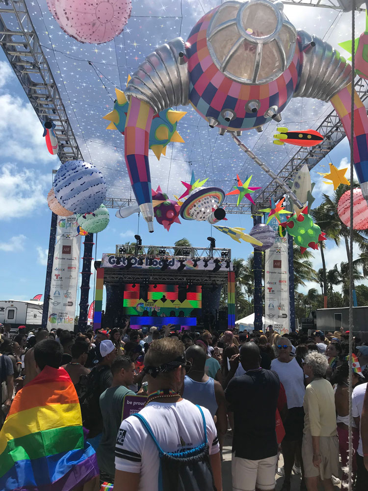 A crowd in front of a stage.