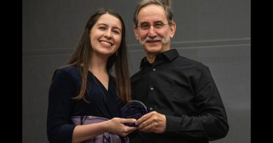 Photo of Rebecca Diaz receiving her award.
