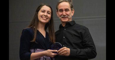 Photo of Rebecca Diaz receiving her Hidden Hero award.
