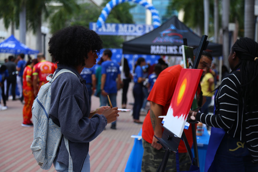 Photo of a student painting during the event.