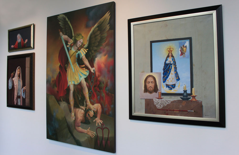 Religious artworks hanging on the wall.