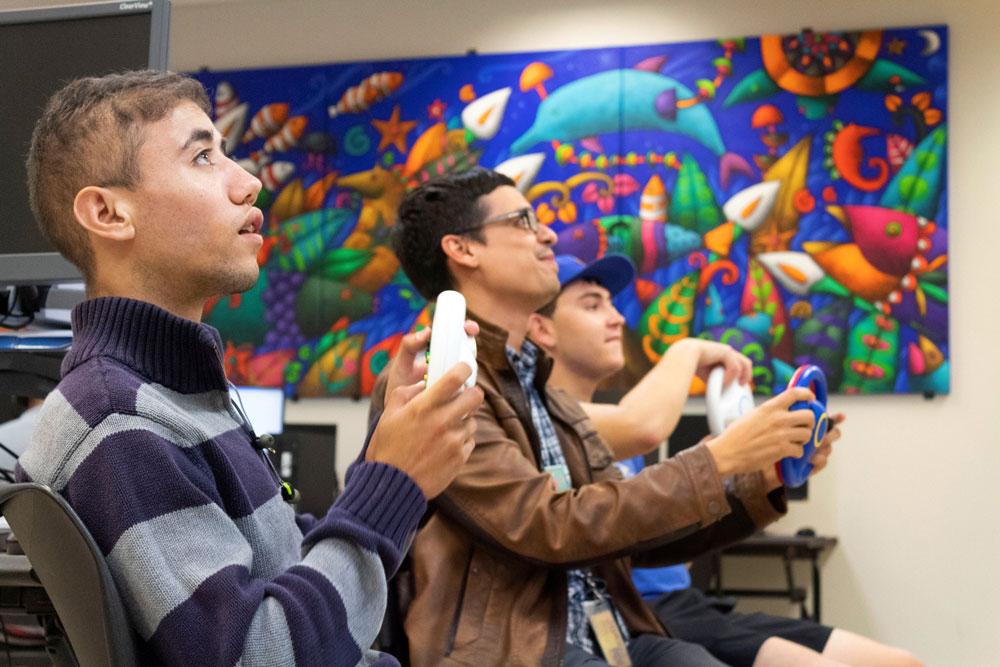 West Campus students playing video games.