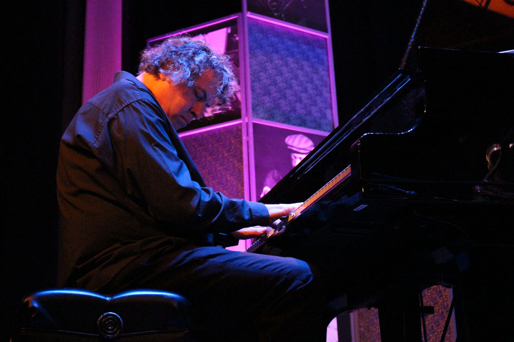 Jim Gasior playing the piano on stage.