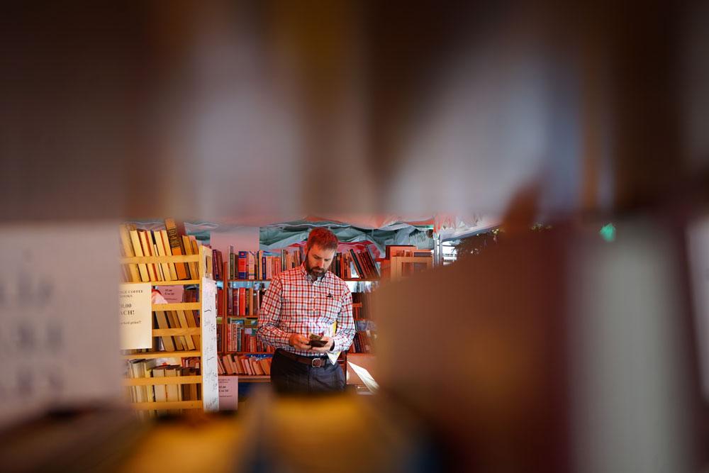 A man purchasing books.