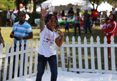 A little girl enjoying the Children's Holiday event.