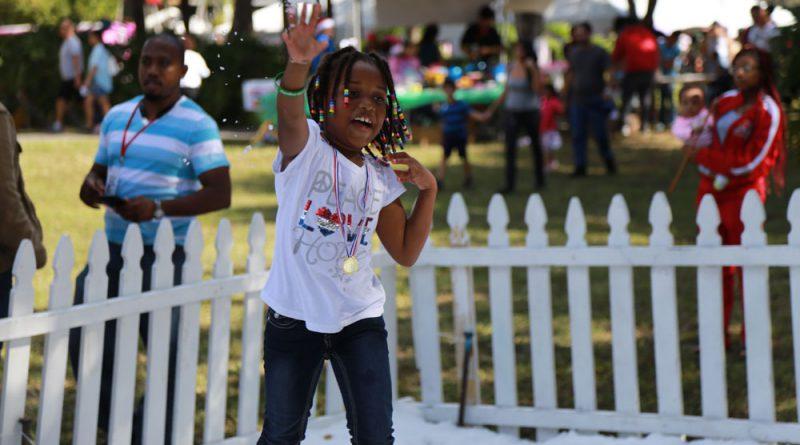 A little girl enjoying the Children's Holiday event.