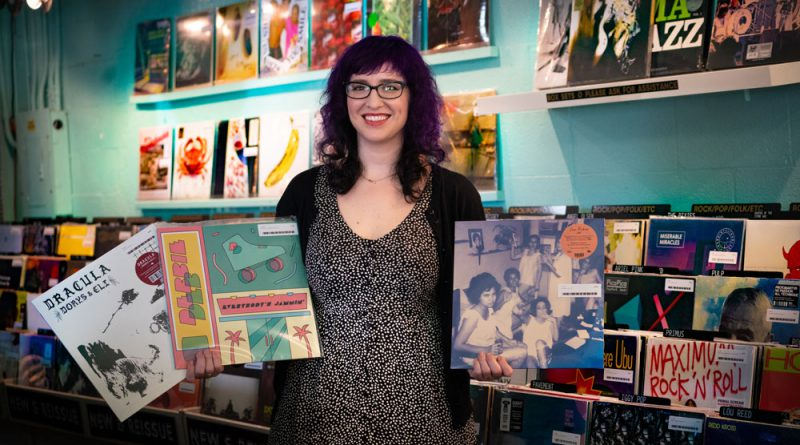 "Lauren ""Lolo"" Reskin showing off her record store."