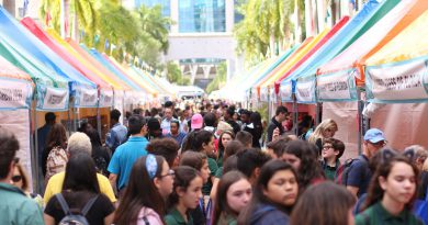 Young students enjoying the Miami Book Fair.