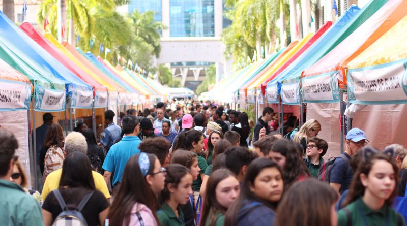 Young students enjoying the Miami Book Fair.