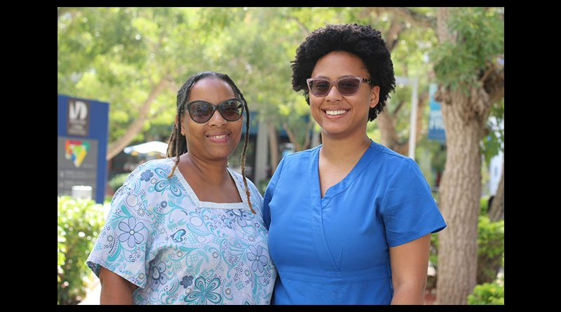 Shawna Powell and Zayna Bryan posing for the camera.