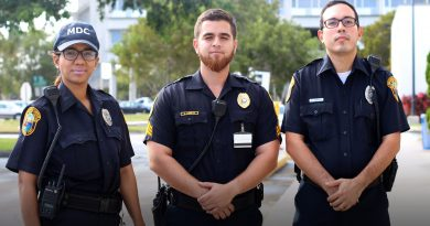 Three public officers posing for the camera.