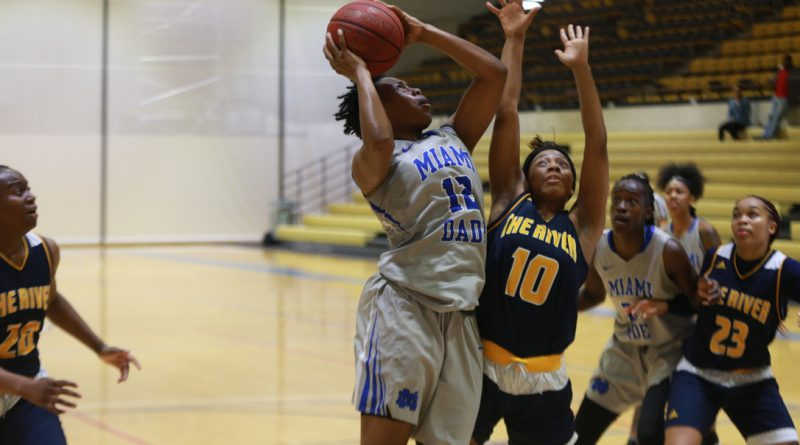 Daliyah Brown trying to score a basketball.