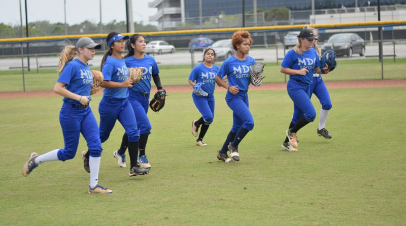 The Lady Sharks softball team at practice.