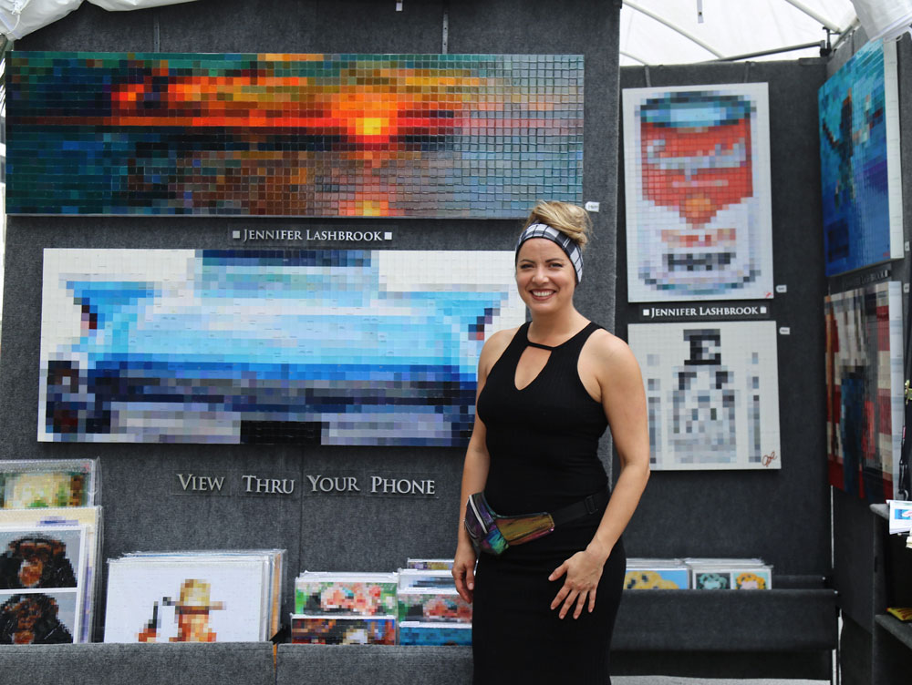 Jennifer Lashbrook posing with her art.