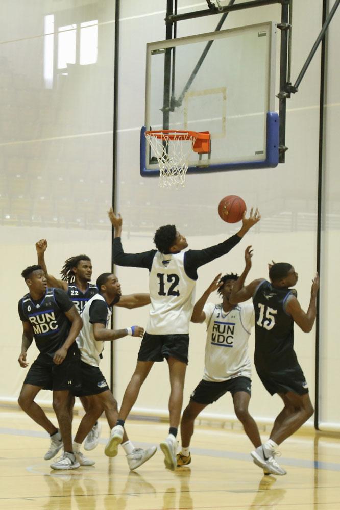MDC men's basketball team on the court.