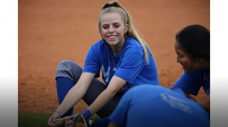 Amber Dalfonso laughing with her teammates.