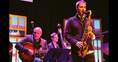 Jazz musician performing on stage.