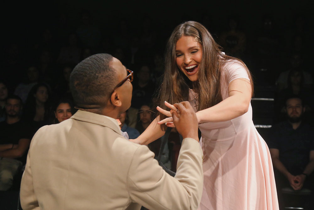 Students Henry Cadet and Kelsy Williams acting on stage.