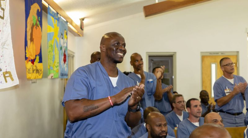 Incarcerated people graduating.