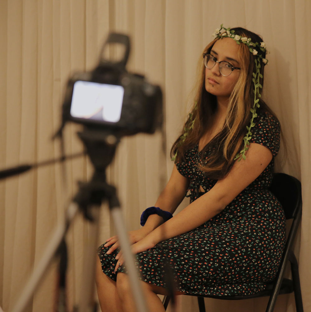 Photographer Alice Moreno posing for her camera.