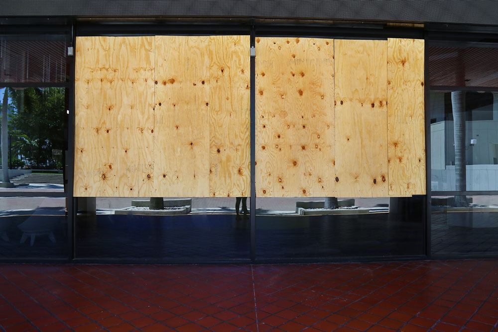 Brokens windows covered with plywood due to George Floyd protests.