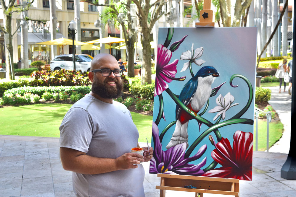 Artist with his artwork.