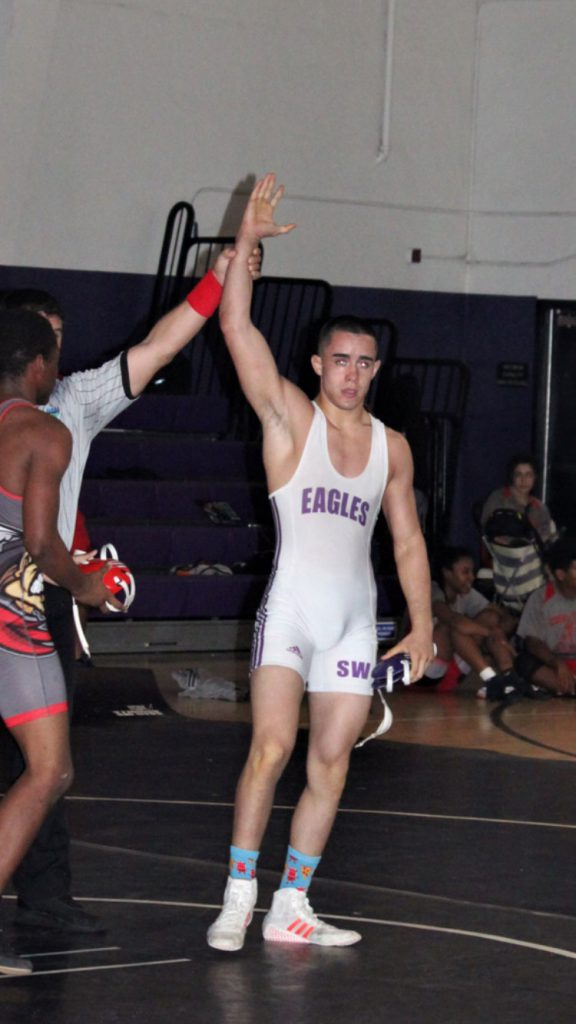 Noel Fuentes winning a wrestling match.